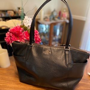 Coach black pebble leather tote with two pockets